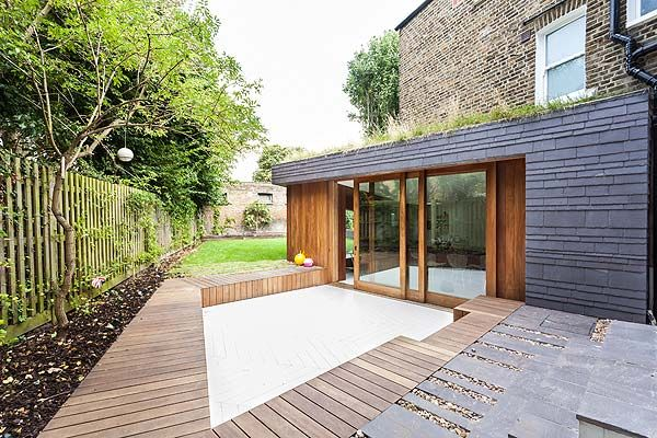 The exterior of the extension is clad in timber and slate clad and the green roof is seeded with meadow flowers