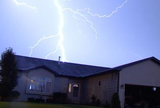 THis link provides an in depth description of lightening safety tips.  It also provides a very quick and condensed overview of the in depth tips it talks about.  While many of the tips seem like common sense, they may be things that you overlook when lightening actually strikes.