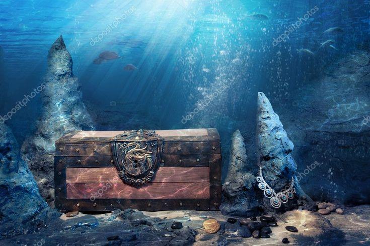 Closed treasure chest underwater stock photo
