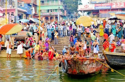 People taking a morning bath in the Ganga river near Varanasi, India.