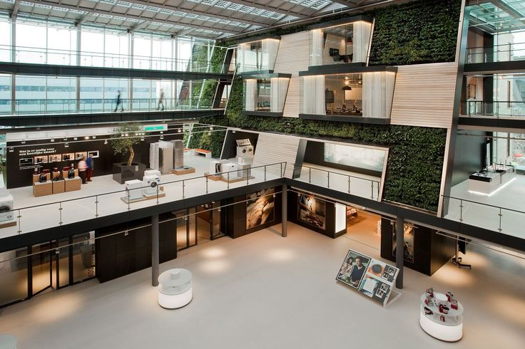 William McDonough + Partners, together with D/DOCK, designed a new office building for Bosch Siemens Hausgeräte (B/S/H/) in Hoofddorp, The Netherlands. At the center of the office, is a four-story atrium with an indoor/outdoor Living Green Wall.