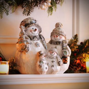 The Frosty Snowman Family Statue brings a wintery touch to your home. #kirklands #holidaydecor #KirklandsHoliday