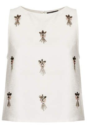 Embellished shell top / $72