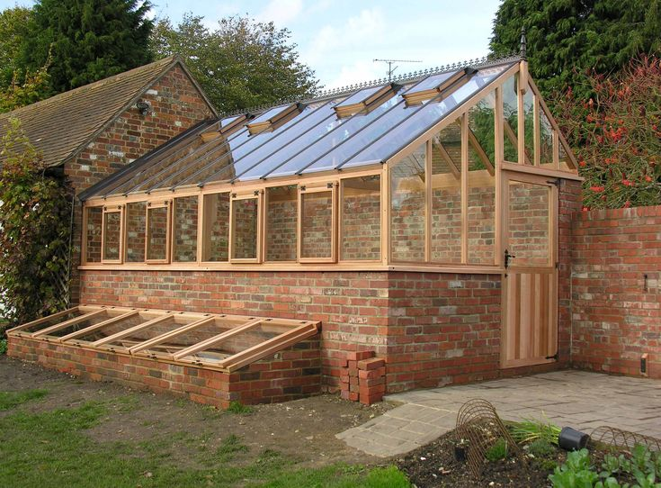 Western Red Cedar Three Quaterspan fitted by Woodpecker Joinery I KNOW it is supposed to be a greenhouse, but I want to live in it. :0)