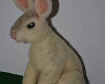 Small Brown and White Needle felted Rabbit. Made with wool from my Shetland Sheep. 2.5 inches tall , well made tightly felted, this rabbit is sold. I can make another one to order.