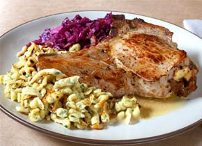 This stuffed pork chop recipe is filled with a pumpernickel-apple stuffing and served with a cider–apple brandy sauce.