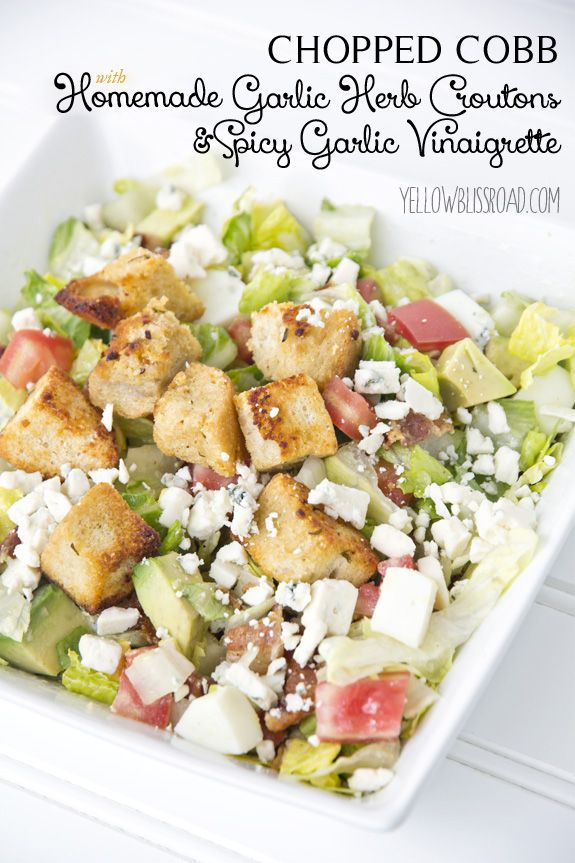 Delicious Chopped Cobb Salad with Spicy Garlic Vinaigrette and Homemade Garlic Herb Croutons - So full of flavor and positively mouth watering!