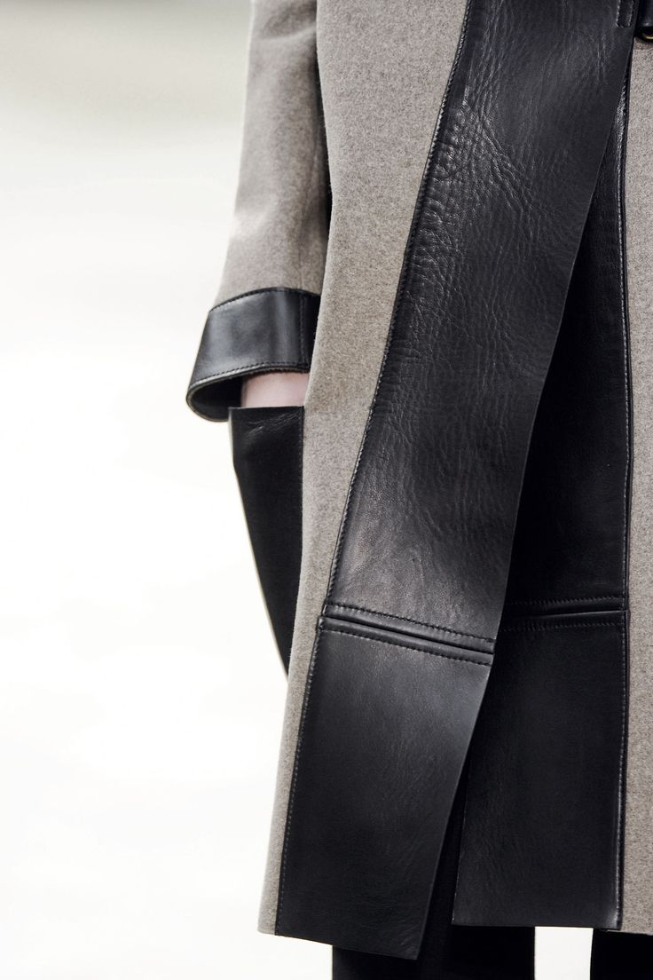 Wool coat with wide leather trim; close up fashion details // Celine