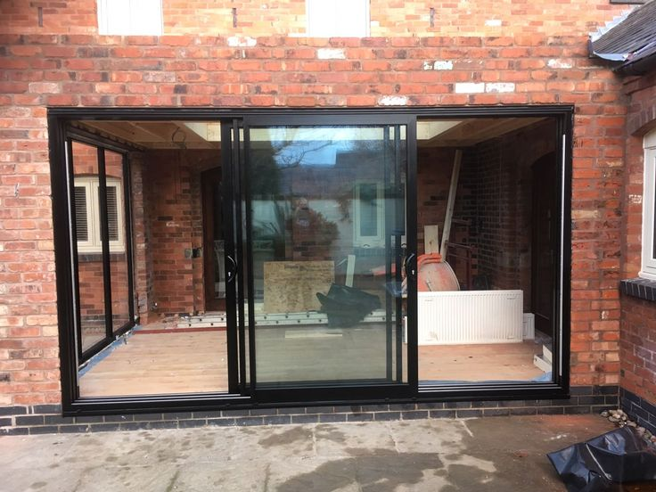 Black Smart Architectural Aluminium Triple Track Sliding Patio Door With  Black Hardware To Match. Installed