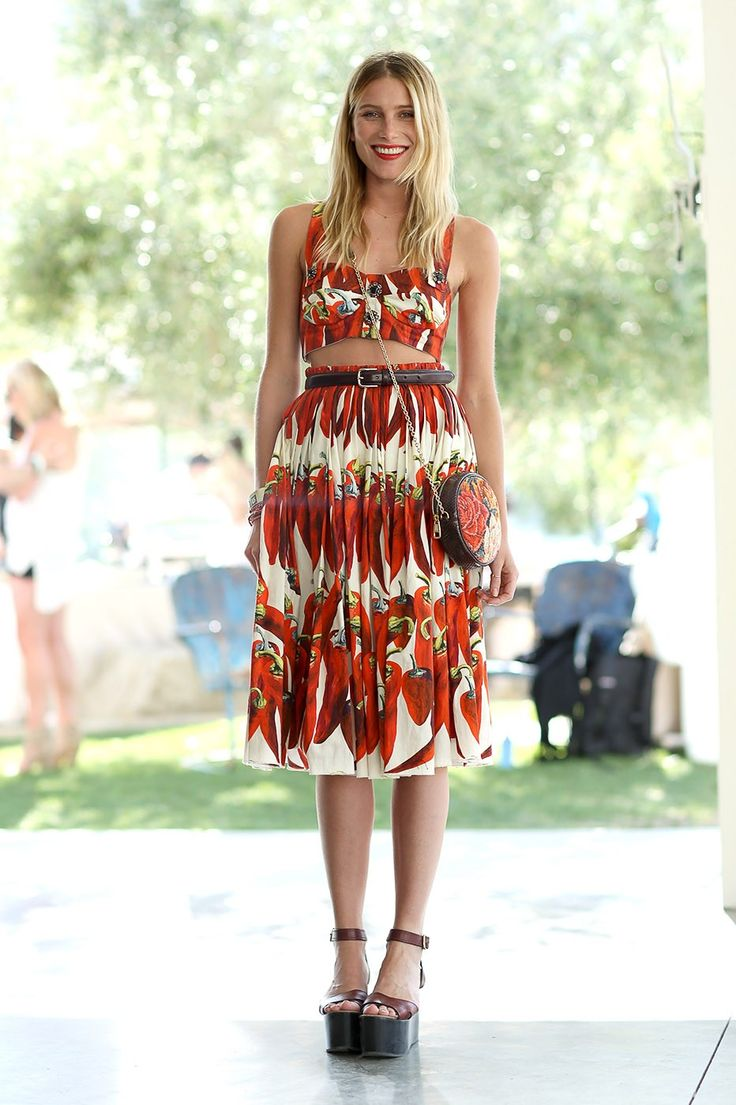 At Coachella, Dree Hemingway paired an orange-print bandeau crop top with a matching skirt. #getzesty