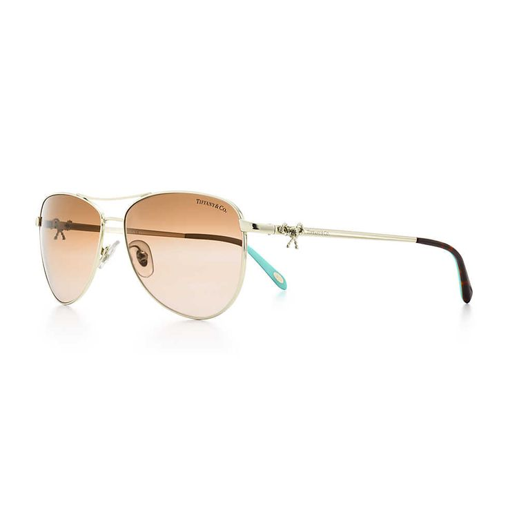 Tiffany Twist aviator bow sunglasses in pale gold-colored metal.