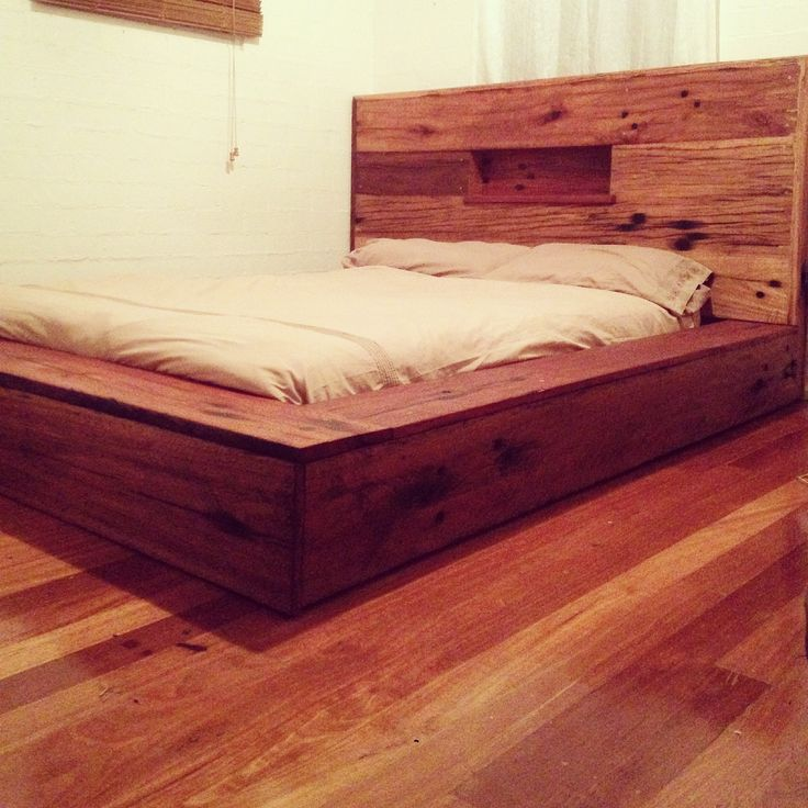 recycled railway sleeper bed, with candle holders