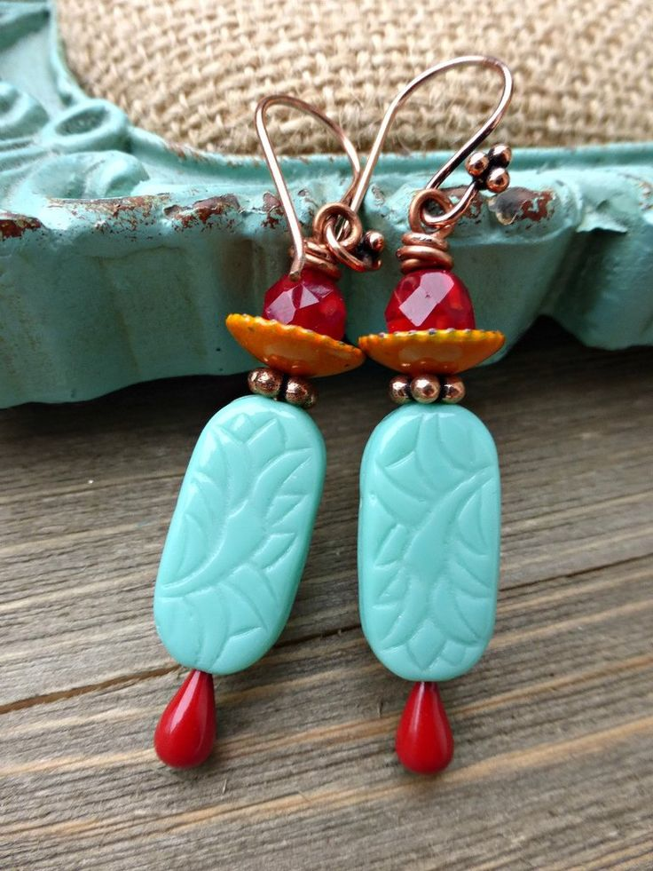 Turquiose and red Czech glass, enameled orange metal, copper medium size earrings.
