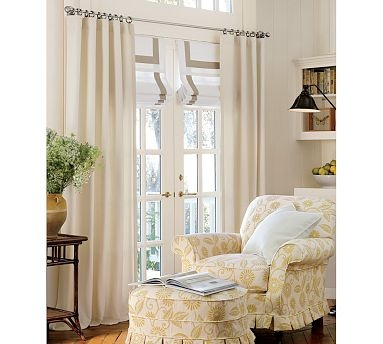 Love the side panels combined with the Roman shades and topper on these French doors (an international affair!) Pottery Barn: