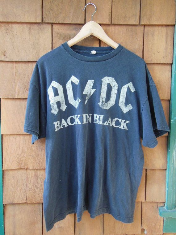 Simple & perfect vintage AC/DC metal tee. Distressed & faded black cotton tee, with AC/DC Back in Black graphic in white. A rare and awesome