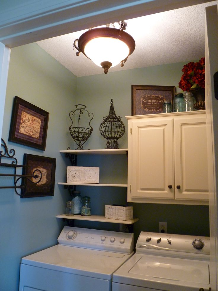 I love my Small French Laundry Room, I have tons of storage and a hanging rack for drying clothes!