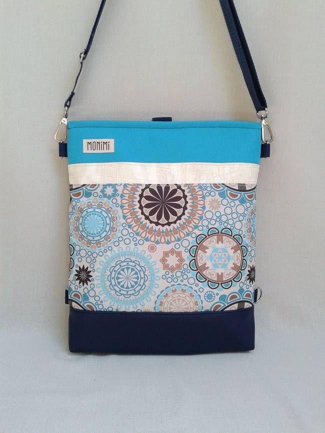 Abszolút nyárias, igazi vízparti ragyogás ez a táska! Vakító türkiz gyöngyvászonnal és kagylóhéj színű műbőr csíkkal kombináltam ezt a szép mandalás anyagot. Csodás kiegészítője lesz idén nyáron a ruhatáradnak! Cross-bag 44 #női #táska #hátizsák