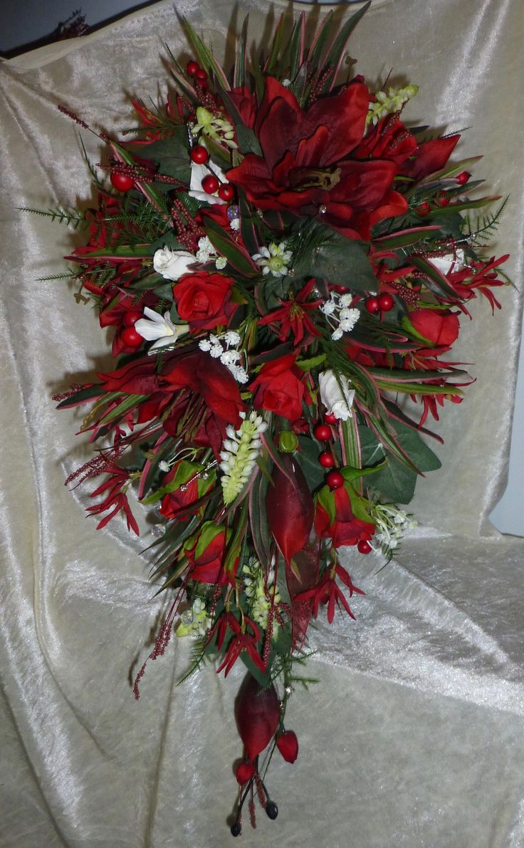 71 best nozze wedding flowers and favours images on pinterest stunning shades of red with a hint of ivory teardrop wedding bouquet of artificial flowers dhlflorist Gallery
