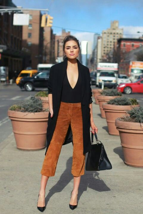 Olivia Culpo - suede camel pants & V neck body suit with black trench