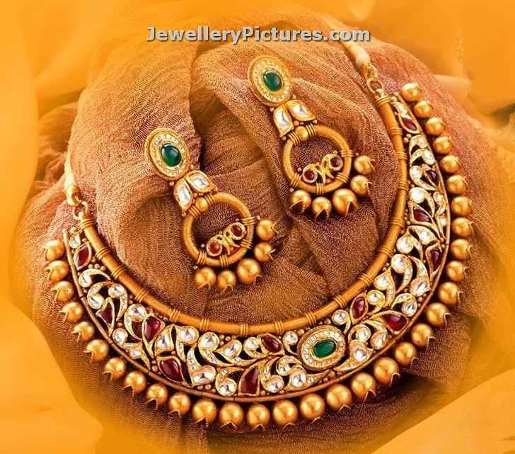 Designer necklace designs in gold studded with kundans and adorned with south sea pearls in golden color.Chandbali earrigs are designed to complement and elevate the beauty of the necklace design. 22 carat gold indian necklace design will fetch you more complement when you wear it. For weight and price contact AVR Swarnamahal E-mail: crm@avrswarnamahal.com Toll free: 1800 …