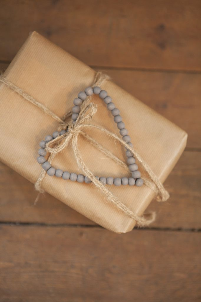 Gift packet in with brown paper, twine and heart of beads