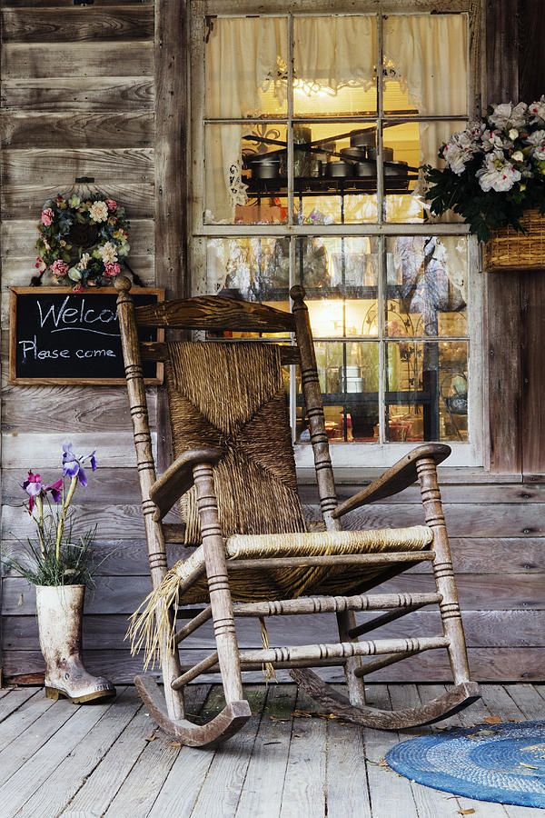 Old Wooden Rocking Chair on a Wooden Porch