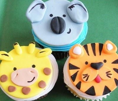 Zoo theme party cupcakes... I like the koala best.