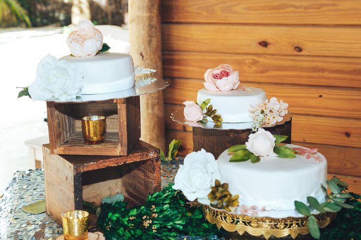Wedding cake with flower toppers. Wedding in Dominican Republic. Saona Island. Wedding organization by weddingdominican.com. Photo by Alex Newman.   #weddingcake #destinationwedding #weddinginpuntacana #caribbeanweddingteam #weddingdecor #beachwedding