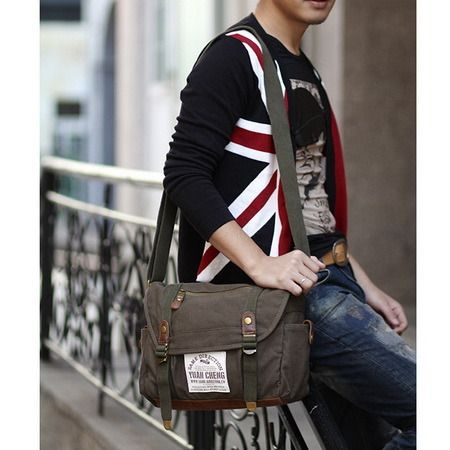 This classic school messenger bag is made from solid cotton canvas body and suede bottom
