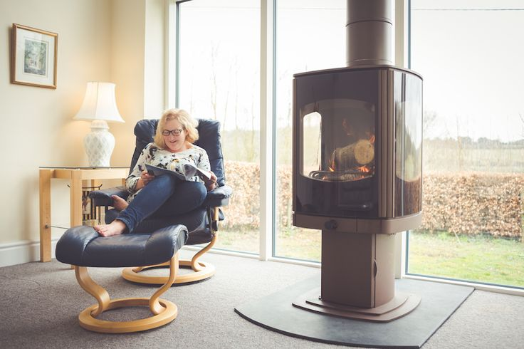 Charnwood Tor 10kW three-sided stove in brown.