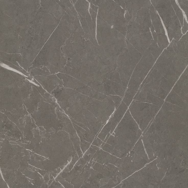 DESIDERIA MARBLE MATERA - A mid toned brown-grey marble with white veins throughout