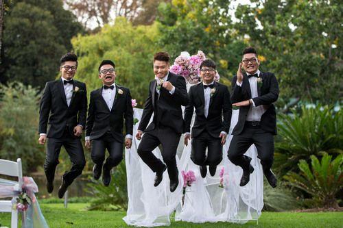 groom and groomsmen jumping