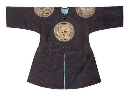 A black satin ground surcoat with embroidered dragon roundels (gunfu). Late Qing Dynasty.