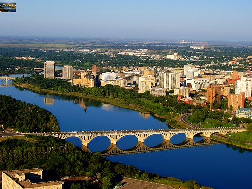 Aerial shot from campus of the University Bridge and downtown Saskatoon by University of Saskatchewan, via Flickr