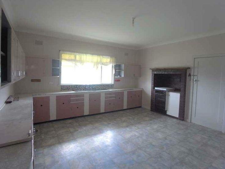 Enormous kitchen on 6.4 acres at Tumbarumba. Camelias. A bit old. $325000.