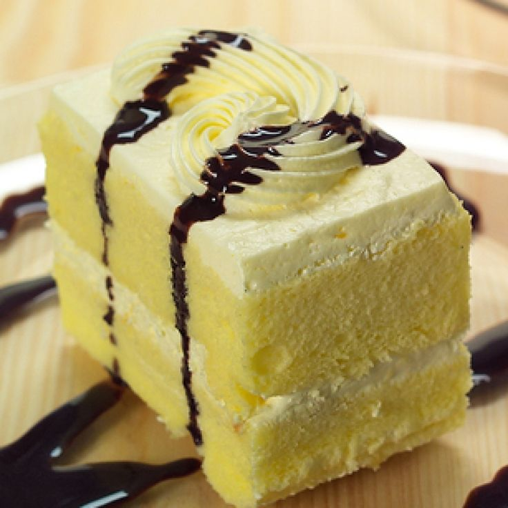This lemon cake recipe is a lovely recipe for those that like a little zest in their dessert choice.  The cake filled and topped with lemon buttercream icing and drizzled with chocolate sauce. A beauty! .  Lemon Sponge Cake  Recipe from Grandmothers Kitchen.