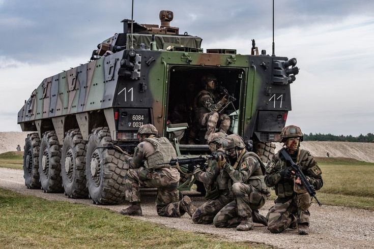 french troops under the cover of the vbci armored personnel carrier during a training exercise. Black Bedroom Furniture Sets. Home Design Ideas