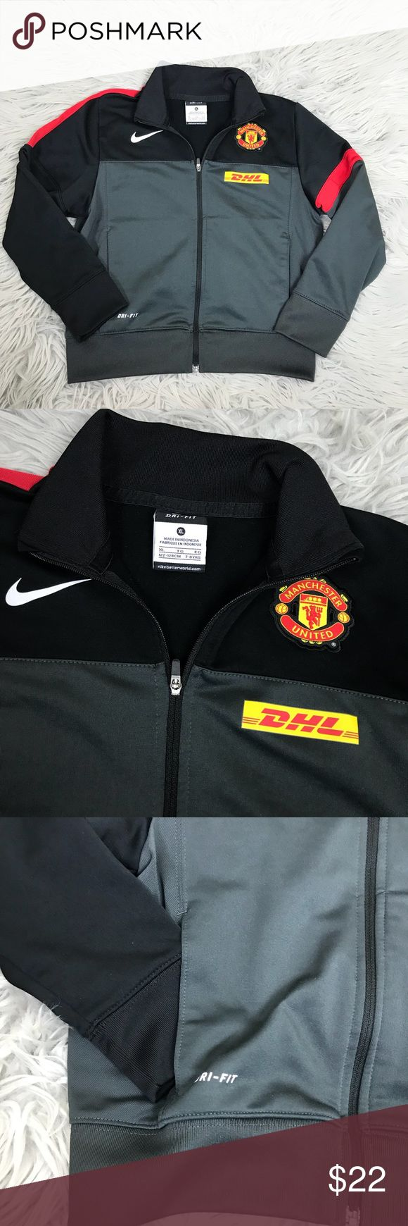 "Nike Manchester United Full Zip Jacket Nike Manchester United Full Zip Jacket. Size XL 7-8 year old. Excellent conditions no flaws and barely any wear. 16.75"" chest, 17"" length Nike Shirts & Tops Sweatshirts & Hoodies"