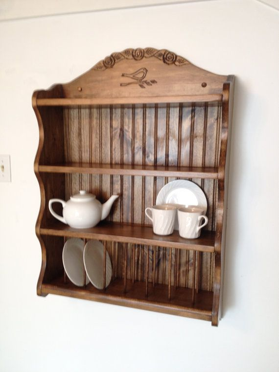 Regina, a lovely tea set shelf , with space for 8 plates, and two other shelves featuring a saucer groove and ample space for other pieces. She