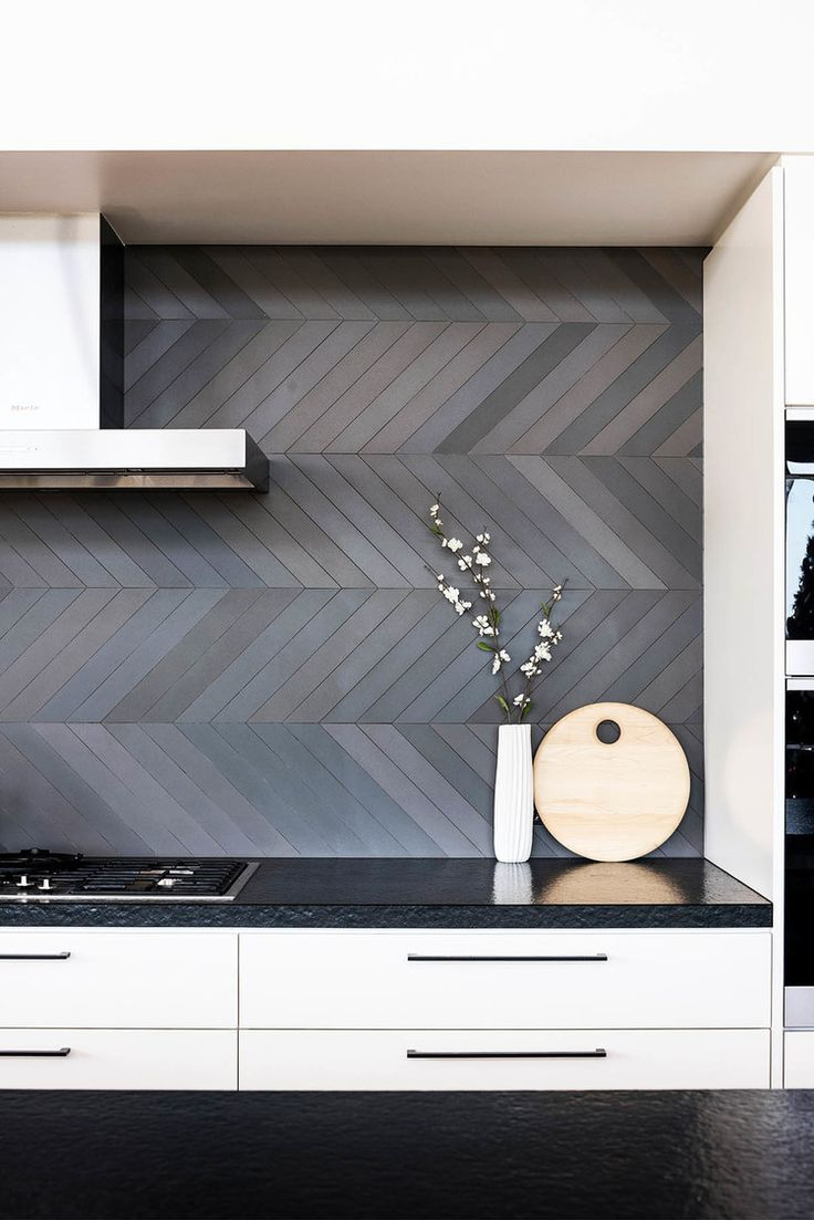 The backsplash and counters are similar tones but are for Unusual kitchen wall tiles