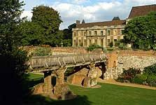Eltham Palace - The bridge over the dry moat with the house and gardens beyond. Boyhood home of King Henry VIII