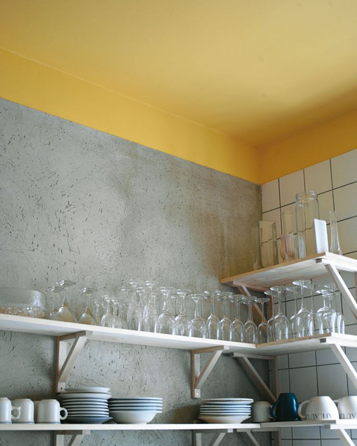 Love the contrast between concrete, painted yellow wall and tiling.