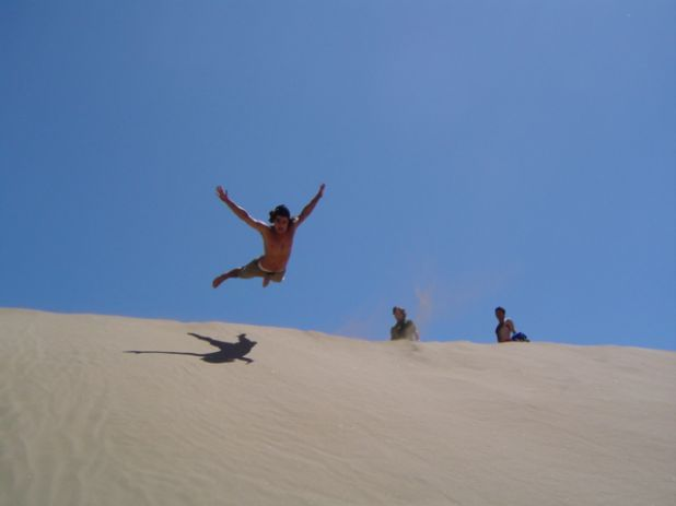 "Is sandboarding considered ""hands-on learning""? more like 'belly-on' right? ;) Either way, it's one of the many activities to enjoy in Chile! #chile #sandboarding #ecela"