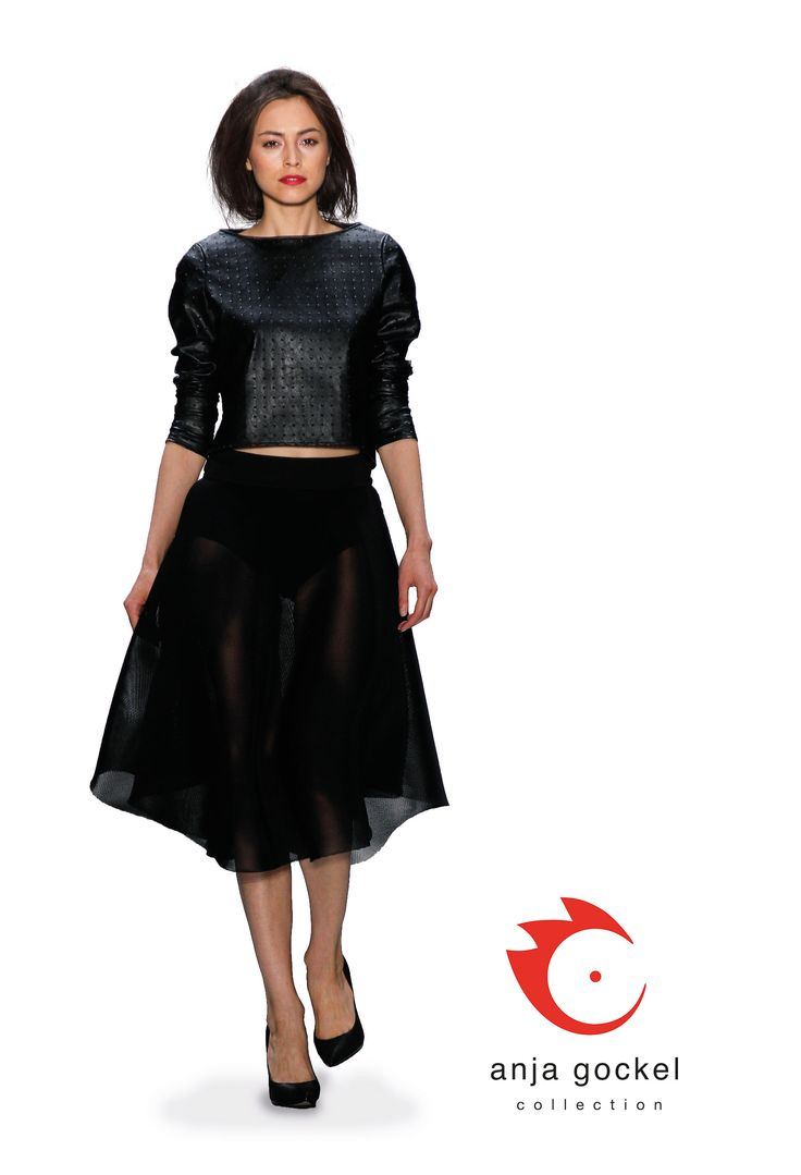 A beautiful short top from fake black leather combined to a circle skirt from lightweight mesh net fabric.