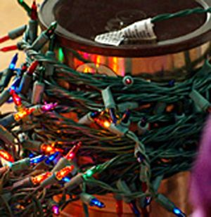 Wrap Christmas lights around a coffee can to keep them untangled.
