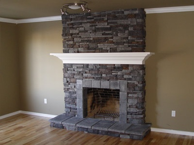 Stacked stone fireplace the will of the candle is strong for Elektrischer kamin weiay