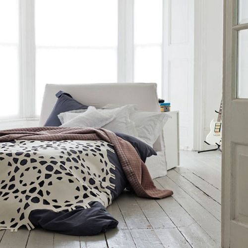Source: Interior Holic  That bed is to die for and that lace felt cut-out throw is pure awesomeness AND it comes in Grey. Perfect! You can pick it up from Room 39 :)