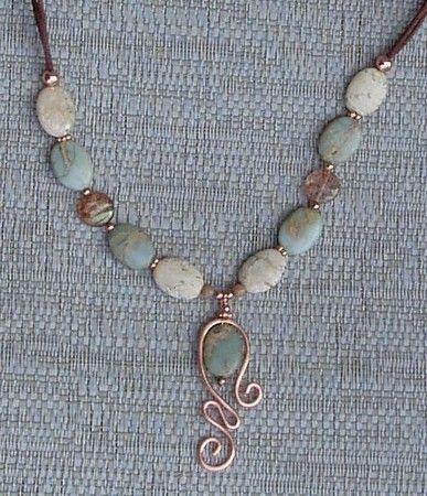 Jasper and copper.  Love the pendant. Lima Beads