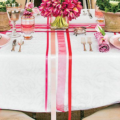 The Runner | To re-create this look, start with six rolls of ribbon. Measure the length and width of your tablecloth to determine the ribbon lengths. (Add a few inches just in case.)