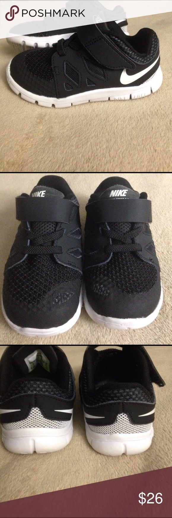 Toddler Nike free 5.0 Gently worn black and white Nike free 5.0! Still in great condition. Velcro with fake laces. Small scuff on the left side of the right shoe (pictured). Tongue has slight wear. Size 6c - Nike Shoes Sneakers